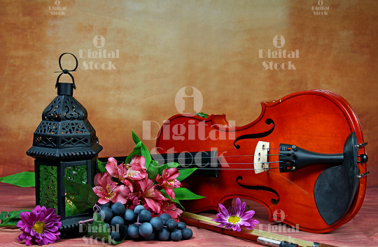 A violin with a lamp and fruits still life